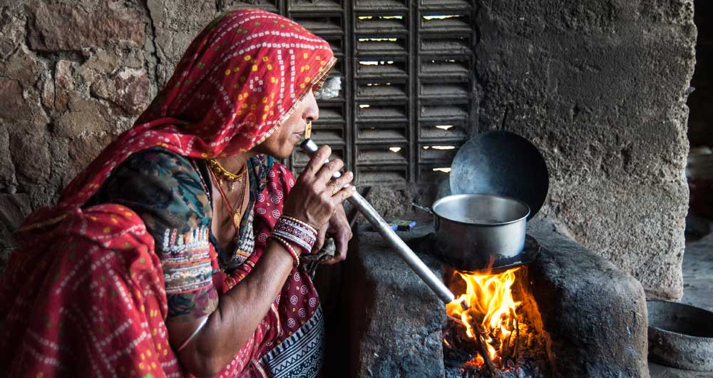 A village woman cooking on a clay stove