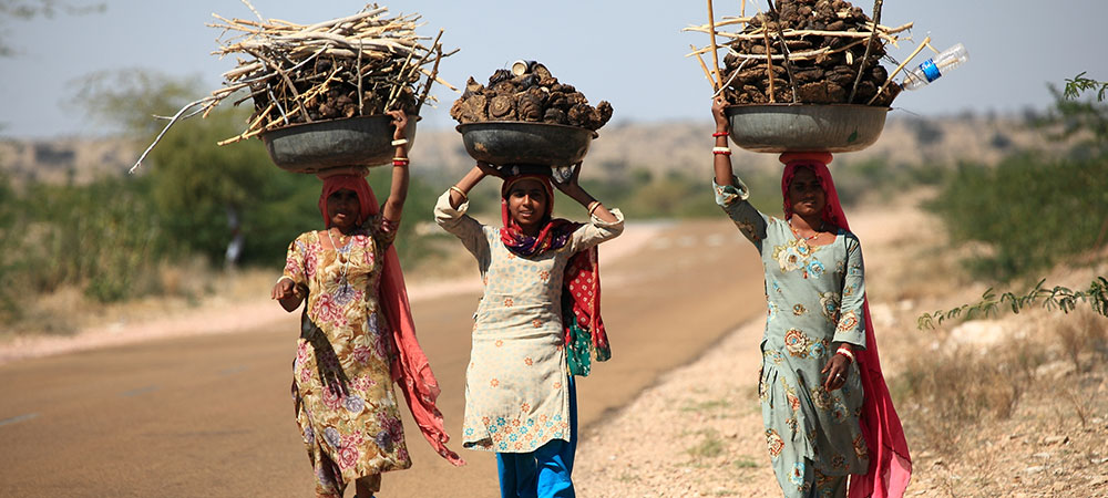 Relying on biomass fuel for cooking not only exposes women to the health risks of indoor air pollution but also to the daily drudgery of procuring firewood or cow dung